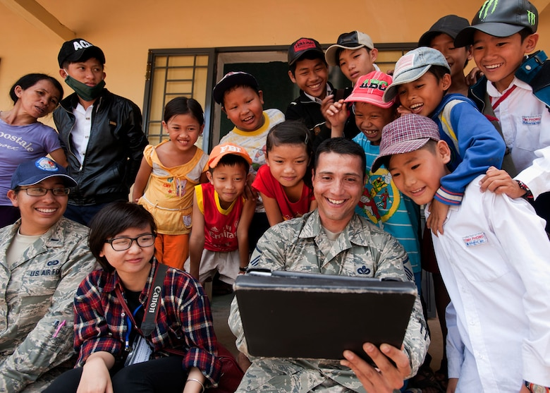 Master Sgt. Erick Lizarraga, 18th Civil Engineer Squadron structural maintenance craftsman, entertains local youths at South Tinh Phong primary school, Quang Ngai province, Vietnam, during an engineering project March 26, 2015. Efforts undertaken during Operation Pacific Angel 2015 help multilateral militaries in the Pacific improve and build relationships across a wide spectrum of civic operations, which bolsters each nation's capacity to respond and support future humanitarian assistance and disaster relief operations. (U.S. Air Force photo/Staff Sgt. Tong Duong)
