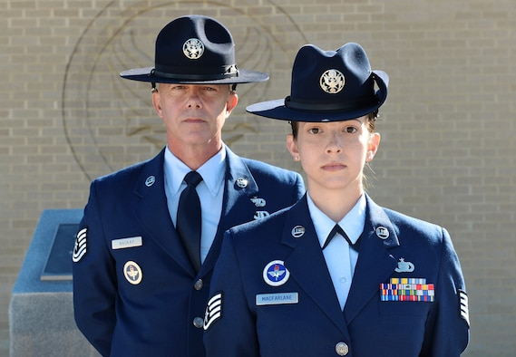 Tech. Sgt. James MacKay and his daughter, Staff Sgt. Amanda MacFarlane, 433rd Training Squadron military training instructors (MTI), pose for a photo on March 27, 2015, at Joint Base San Antonio-Lackland, Texas. MacKay and MacFarlane are the first father and daughter duo serving as MTIs at the same time. (U.S. Air Force photo/Benjamin Faske)