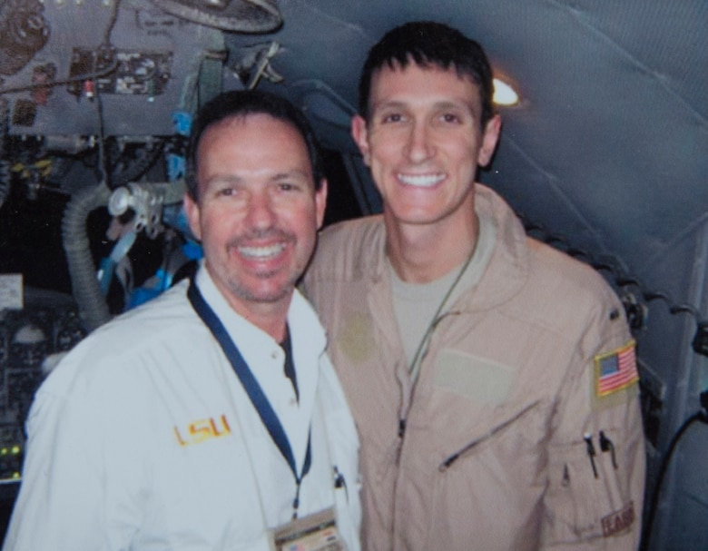 First Lt. Kenneth Jubb, a C-130J Super Hercules, stands next to his father, Stephen Jubb, in Southwest Asia. Stephen traveled to the Middle East to teach the locals how to properly control air traffic while Kenneth was deployed close by. Stephen took advantage of the opportunity and was able to direct his son's landing for the first time during a mission. (Courtesy photo)