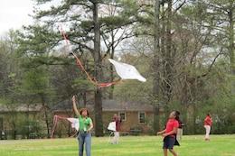Huntsville Center Energy Team flies kites with students.