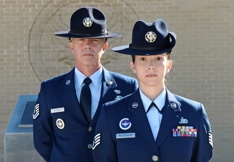 Tech. Sgt. James MacKay and his daughter, Staff Sgt. Amanda MacFarlane, 433rd Training Squadron military training instructors, pose for a photo on March 27, 2015, at Joint Base San Antonio-Lackland, Texas. MacKay and MacFarlane are the first father and daughter duo serving as MTIs at the same time. (U.S. Air Force photo/Benjamin Faske)