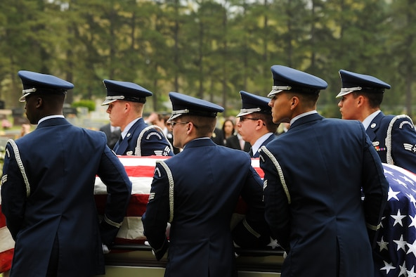 Members of the Little Rock Air Force Base Honor Guard carry the casket of Lt. Col. Robert Hite, a World War II Doolittle Raider, April 2, 2015, in Camden, Ark. After the raid, Hite, along with eight other men, was captured and held as a Japenese prisoner of war until he was liberated from captivity Aug. 20, 1945. (U.S. Air Force photo by Airman 1st Class Mercedes Muro)