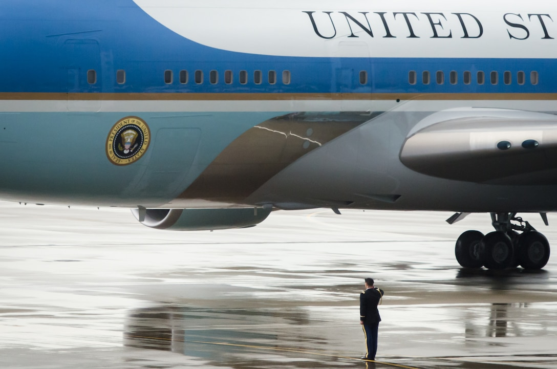 A U.S. Army Soldier salutes Air Force One April 2, 2015, as it arrives at the Kentucky Air National Guard Base in Louisville, Ky., carrying President Barack Obama. The president was in town to speak about job training and economic development. (U.S. Air National Guard photo by Maj. Dale Greer)