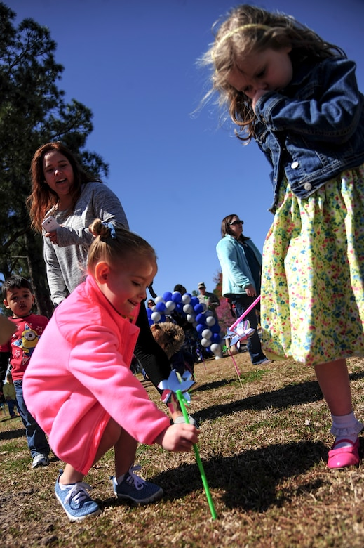 "Children of Team Seymour plant pinwheels during a ""Pinwheels for Child Abuse Prevention"" event, April 1, 2015, at Seymour Johnson Air Force Base, North Carolina. Every April is recognized as Child Abuse Prevention Month and acknowledges the importance of families and communities working together to prevent child abuse and neglect. (U.S Air Force photo/Senior Airman Brittain Crolley)"