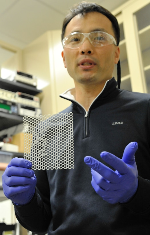 Air Force Research Laboratory Materials and Manufacturing Directorate research scientist Steve Kim displays a 3D model of graphene, a type of carbon that can be used in developing nanoelectronic sensors for human-performance monitoring. Graphene has unique, natural electronic binding properties that are allowing Air Force scientists at AFRL/RX, Wright-Patterson Air Force Base, to develop a low-cost, manufacturable bio-sensing platform that is capable of achieving ultrasensitive molecular detection. (Air Force photo by Michele Eaton)