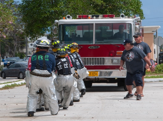 HAGATNA, Guam – Andersen Air Force Base firefighters pull a fire truck during the 2015 Firefighter Muster and Competition in Hagatna March 28. The goal of the event was to promote camaraderie and trust in order to strengthen partnerships between all fire departments on Guam. (U.S. Navy photo by Leah Eclavea/Released)