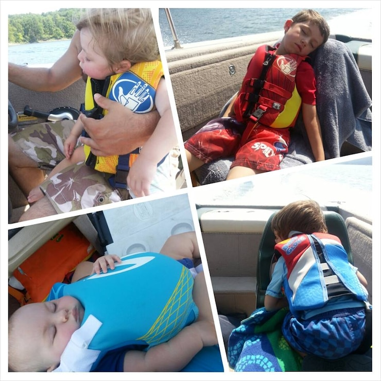Four boys asleep on boat on Lake Ouachita.