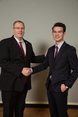 David Neaverth, Senate Youth Program Delegate, poses for a picture with Deputy Secretary of Defense Robert O. Work in Washington D.C. in March. Neaverth was one of only 104 high school students chosen for the program.