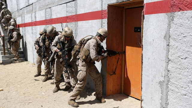 Marines with Charlie Company, 1st Reconnaissance Battalion, wait in file before breaching a door during a live-fire raid at Range 226 aboard Camp Pendleton, Calif., April 1, 2015. The company conducted the live-fire exercise as part of a predeployment workup in support of the 13th Marine Expeditionary Unit.