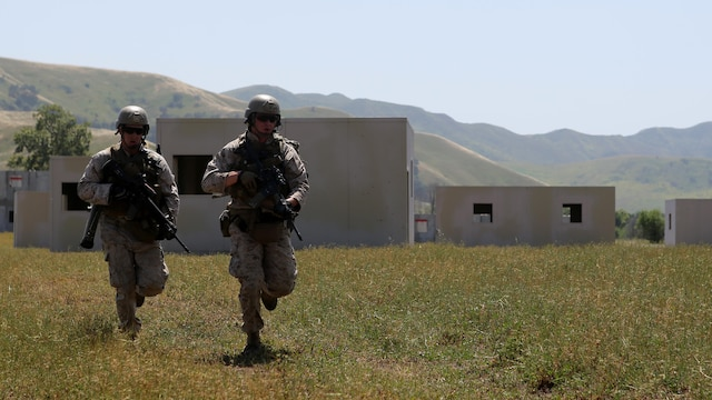 Marines with Charlie Company, 1st Reconnaissance Battalion, sprint across a field during a live-fire raid at Range 226 aboard Camp Pendleton, Calif., April 1, 2015. The company conducted the live-fire exercise as part of a predeployment workup in support of the 13th Marine Expeditionary Unit.