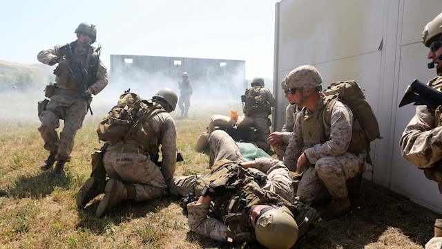 Marines with Charlie Company, 1st Reconnaissance Battalion, provide medical aid to a simulated casualty during a live-fire raid at Range 226 aboard Camp Pendleton, Calif., April 1, 2015. The company conducted the live-fire exercise as part of a predeployment workup in support of the 13th Marine Expeditionary Unit.