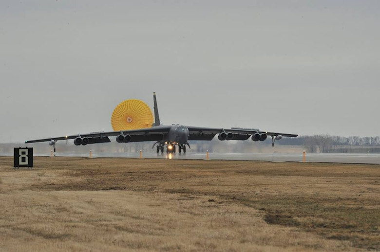 A B-52H Stratofortress lands at Minot Air Force Base, N.D., Apr. 2, 2015, after completing a U.S. Strategic Command-directed training mission, Polar Growl. The round-trip sortie from their home base to the North Sea region allowed the aircrews to hone their navigation skills and enhanced their ability to work with allied partners. STRATCOM is one of nine Defense Department unified combatant commands and is charged with strategic deterrence; space operations; cyberspace operations; joint electronic warfare; global strike; missile defense; intelligence, surveillance and reconnaissance; combating weapons of mass destruction; and analysis and targeting. (U.S. Air Force photo/Senior Airman Malia Jenkins)