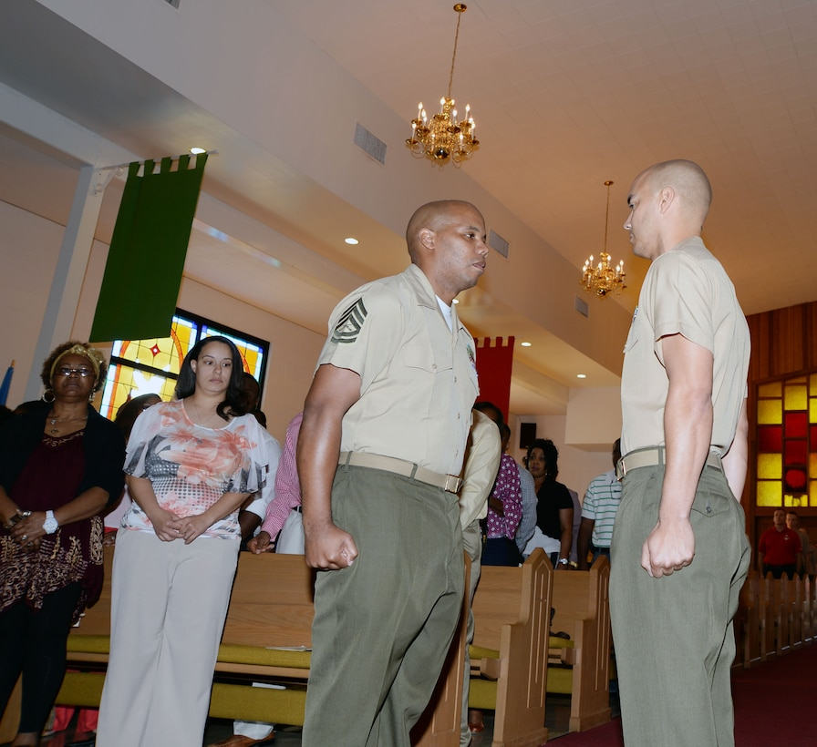 Capt. Ken Barber, (left) Communication and Information Systems Division, prepares to present Gunnery Sgt. Charles Kinsey with an award during Kinsey's retirement, April 3, at the Chapel of the Good Shepherd, here.