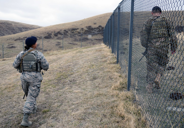 341st Missile Security Forces Squadron members perform a perimeter sweep March 16, 2015, at a missile alert facility near Malmstrom Air Force Base, Mont. Security forces members regularly check the perimeter for any signs of a breach, as well as cleanliness. (U.S. Air Force photo/Airman 1st Class Dillon Johnston)