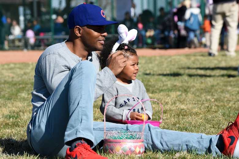 Team Buckley members sit down and relax after the Easter egg hunt during the Breakfast with Bunny event April 4, 2015, at the softball fields on Buckley Air Force Base, Colo. The event included a free pancake breakfast and Easter egg hunts for different age groups. (U.S. Air Force photo by Airman 1st Class Emily E. Amyotte/Released)