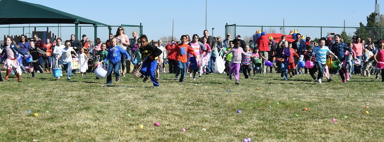 Children take off to hunt for Easter eggs during the Breakfast with Bunny event April 4, 2015, at the softball fields on Buckley Air Force Base, Colo. The event included a free pancake breakfast and Easter egg hunts for different age groups. (U.S. Air Force photo by Airman 1st Class Emily E. Amyotte/Released)