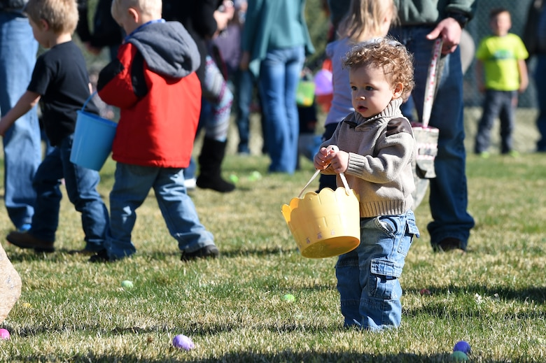 A Team Buckley child searches for Easter eggs during the Breakfast with Bunny event April 4, 2015, at the softball fields on Buckley Air Force Base, Colo. The event included a free pancake breakfast and Easter egg hunts for different age groups. (U.S. Air Force photo by Airman 1st Class Emily E. Amyotte/Released)