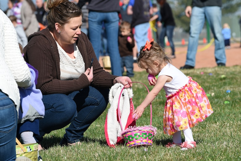 Team Buckley members search through their Easter eggs during the Breakfast with Bunny event April 4, 2015, at the softball fields on Buckley Air Force Base, Colo. The event included a free pancake breakfast and Easter egg hunts for different age groups. (U.S. Air Force photo by Airman 1st Class Emily E. Amyotte/Released)