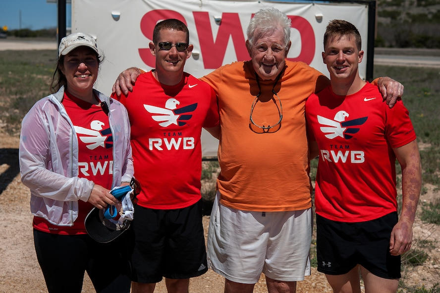 STERLING CITY, Texas -- Ernie Andrus, Navy World War II veteran, poses for a photo with Team Red White and Blue members March 26. Team RWB accompanied Andrus in his 7.11 mile run through Sterling City. (U.S. Air force photo/ Airman 1st Class Devin Boyer)