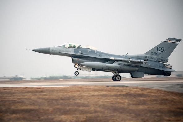 An F-16 Fighting Falcon from the 140th Wing, Colorado Air National Guard, touches down on the runway at Kunsan Air Base, Republic of Korea, Feb. 15, 2015. The 140th jets along with more than 200 Airmen are temporarily stationed at Kunsan for three to four months as part of a rotational Theater Security Package. (U.S. Air Force photo by Senior Airman Taylor Curry/Released)