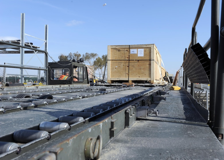 A crate sits on a K loader prior to being transported to an aircraft in support of retrograde operations March 20, 2015 at Kandahar Airfield, Afghanistan. At the height of retrograde in 2014, Airmen assigned to the 451st Expeditionary Logistics Readiness Squadron were responsible for shipping more than 9,000 tons of cargo each month. (U.S. Air Force photo by Staff Sgt. Whitney Amstutz/released)