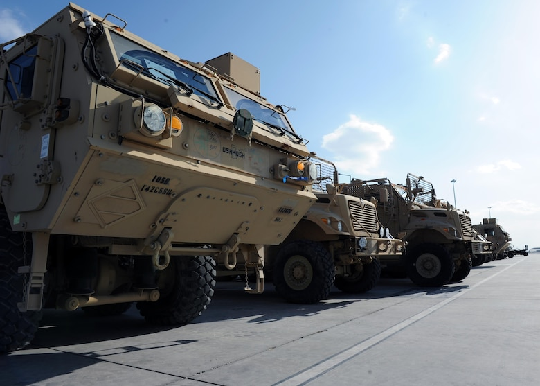 Tactical vehicles sit on the flightline prior to being transported to an aircraft in support of retrograde operations March 20, 2015 at Kandahar Airfield, Afghanistan. At the height of retrograde in 2014, Airmen assigned to the 451st Expeditionary Logistics Readiness Squadron were responsible for shipping more than 9,000 tons of cargo each month. (U.S. Air Force photo by Staff Sgt. Whitney Amstutz/released)
