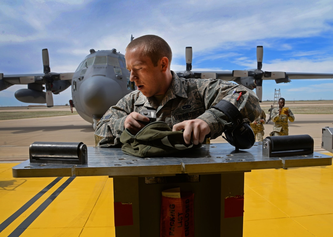 U.S. Air Force Airman 1st Class David Coulter, 27th Special Operations Maintenance Squadron AC-130 armament shop, preps a multi-purpose adapter for munitions transition during a load competition April 6, 2015 at Cannon Air Force Base, N.M. Cannon's elite weapons Air Commandos gathered in a newly renovated hangar for a bit of friendly competition geared toward promoting pride within their career field and a sense of camaraderie among crew members. (U.S. Air Force photo/Staff Sgt. Alex Mercer)
