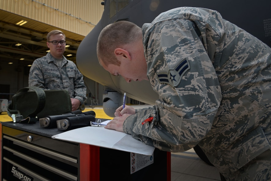 U.S. Air Force Airman 1st Class David Coulter, 27th Special Operations Maintenance Squadron AC-130 armament shop, annotates information in aircraft forms pertaining to what was loaded during a load competition April 6, 2015 at Cannon Air Force Base, N.M. Both teams moved quickly and efficiently to claim the title of Air Force Special Operations Command's first load crew of the year. (U.S. Air Force photo/Staff Sgt. Alex Mercer)