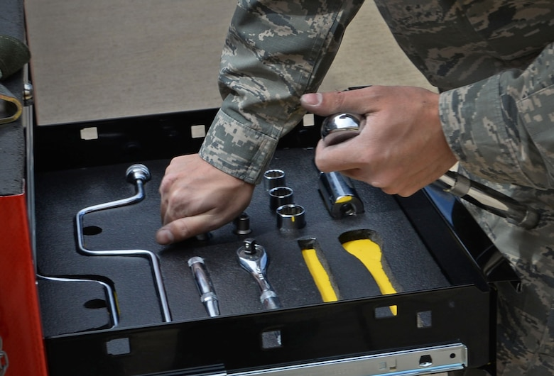 U.S. Air Force Airman 1st Class Ryan Burtis, 27th Special Operations Maintenance Squadron AC-130 armament shop, stores all tools required during a load competition April 6, 2015 at Cannon Air Force Base, N.M. This was one of the final tasks accomplished by the AC-130W team before objective completion. (U.S. Air Force photo/Staff Sgt. Alex Mercer)