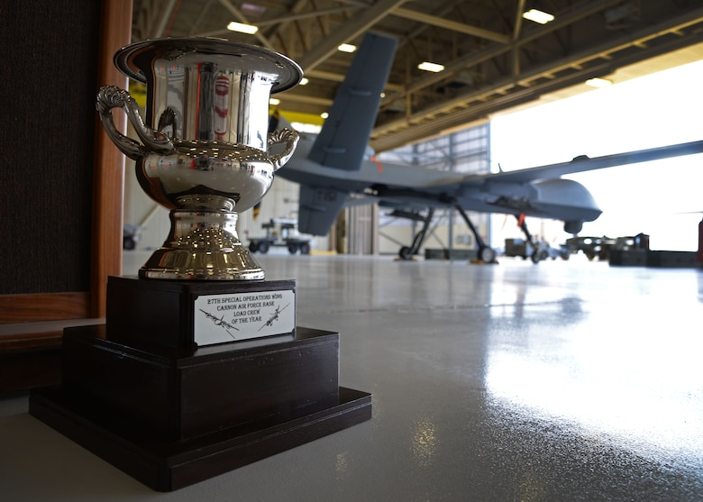 The 27th Special Operations Wing load crew of the year trophy is displayed near competition grounds April 6, 2015 at Cannon Air Force Base, N.M. Cannon's weapons troops gathered for the first ever load competition in Air Force Special Operations Command history. (U.S. Air Force photo/Staff Sgt. Alex Mercer)