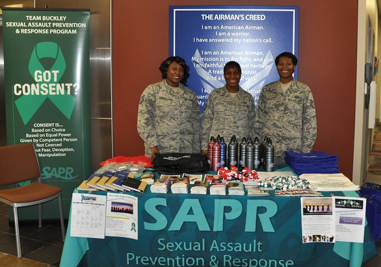 Air Reserve Personnel Center Sexual Assault Prevention and Response representatives Tech. Sgt. Wynetta Thomas, Master Sgt. Joi Pearson and Tech. Sgt. Letitia Edwards bring awareness and are available to provide assistance to ARPC professionals during Sexual Assault Awareness Month April 7, 2015, on Buckley Air Force Base, Colo. (U.S. Air Force photo/Cindy Dewey)