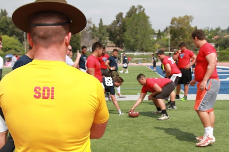FULLERTON, Cali., - Approximately 120 athletes participate in drills during the Semper Fidelis All-American Football Camp here, March 22, 2015. These Camps are the first phase of the Semper Fidelis Football Program. Open to high schools students in 9th, 10th and 11th grade, Semper Fidelis All-American Camps not only hone football skills, but also teach players about Marine Corps values both on and off the field. (U.S. Marine Corps photo by Sgt. Vanessa Jimenez/Released)
