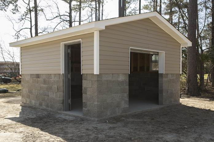 """Marines with 8th Engineer Support Battalion, 2nd Marine Logistics Group, completed the construction of a storage facility, April 2, 2015, aboard Camp Lejeune, N.C. The project was used as training for an upcoming deployment. The unit will use the same skills to build schools and other facilities overseas. """"I think the Marines did very well, said Sgt. Christopher Panko, a combat engineer with 8th ESB and Springfield, Pa., native. """"Starting at the beginning, they didn't know very much at all – we had to teach them a lot of things, but now that we're done with it I think they learned a lot – I learned a lot. I think everything turned out really well."""" (U.S. Marine Corps photo by Cpl. Elizabeth A. Case/Released)"""