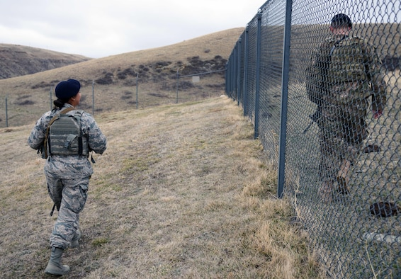 Members of the 341st Missile Security Forces Squadron perform a perimeter sweep March 16, 2015, at a missile alert facility near Malmstrom Air Force Base, Mont. Security forces members regularly check the perimeter for any signs of a breach, as well as cleanliness. (U.S. Air Force photo/Airman 1st Class Dillon Johnston)