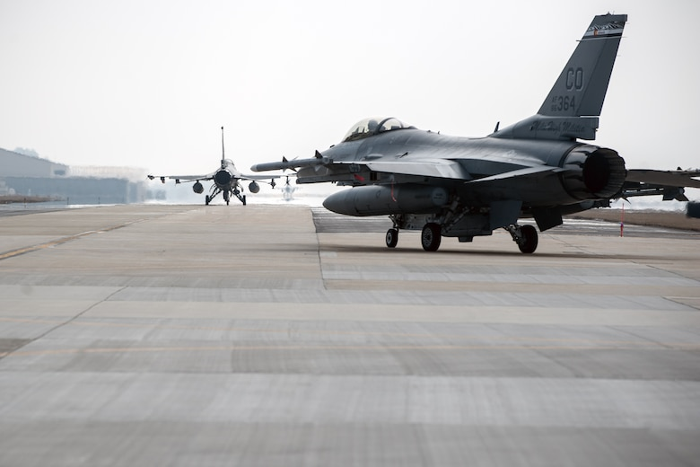 An F-16 Fighting Falcon from the 140th Wing, Colorado Air National Guard, taxis on the runway at Kunsan Air Base, South Korea, March 6, 2015. The jets, along with more than 200 Airmen, are temporarily stationed at Kunsan for three to four months as part of a rotational Theater Security Package. (U.S. Air Force photo/Senior Airman Taylor Curry)