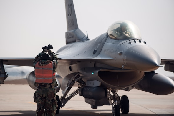 Tech Sgt. Phillip Suchicital, a 8th Aircraft Maintenance Squadron end of runway NCO in charge, marshals in an F-16 Fighting Falcon from the 140th Wing, Colorado Air National Guard, during Exercise Beverly Midnight 15-2 at Kunsan Air Base, South Korea, March 6, 2015. BM 15-2 tested Airmen on their ability to survive and operate while under the stress of simulated wartime activities, all while ensuring aircraft generate. (U.S. Air Force photo/Senior Airman Taylor Curry)