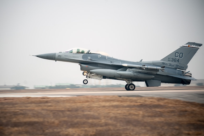 An F-16 Fighting Falcon from the 140th Wing, Colorado Air National Guard, touches down on the runway at Kunsan Air Base, South Korea, Feb. 15, 2015. The jets, along with more than 200 Airmen, are temporarily stationed at Kunsan for three to four months as part of a rotational Theater Security Package. (U.S. Air Force photo/Senior Airman Taylor Curry)