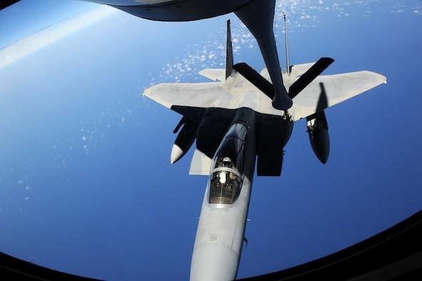 An F-15C Eagle from Kadena Air Base, Japan, receives fuel from a KC-135 Stratotanker during the Forceful Tiger exercise over the Pacific Ocean April 1, 2015. During the exercise, the Stratotankers provided about 800,000 pounds of fuel to 50 aircraft, enabling them to stay airborne for more than four hours. (U.S. Air Force photo /Airman 1st Class Zade C. Vadnais)