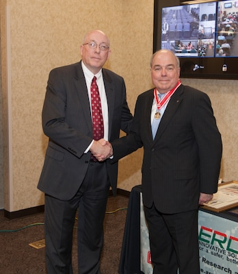 Former ERDC Deputy Director Dr. John Cullinane was presented with the Silver de Fleury Medal by ERDC Director Dr. Jeff Holland as a part of his recent retirement celebration.