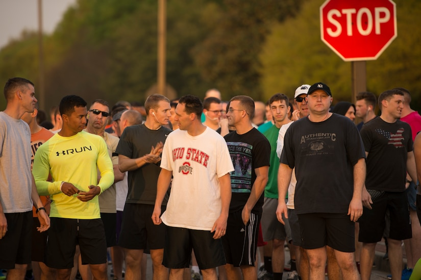 """Participants of the Joint Base Charleston Sexual Assault Awareness Month 5K Walk/Run line up at the starting line April 4, 2015, JB Charleston, S.C. The month of April has been declared the official SAAM for JB Charleston with a theme of """"Eliminate sexual assault: Know your part. Do your part."""" Events will be held throughout the month to help promote awareness. (U.S. Air Force photo / Airman 1st  Class Taylor Queen)"""