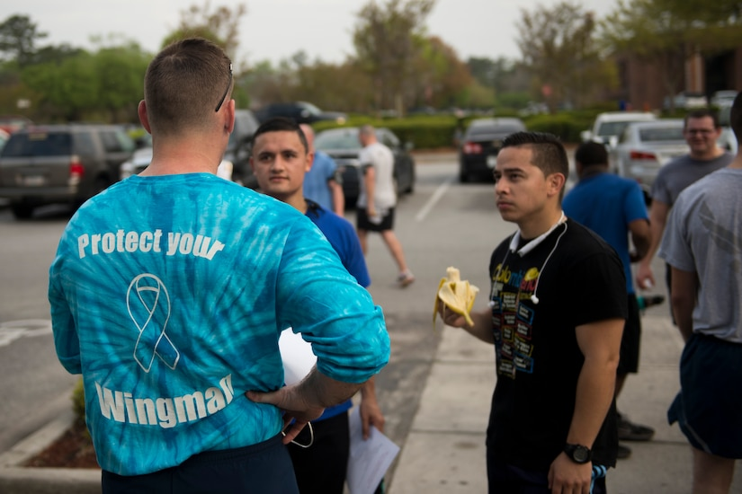 """Chief Master Sgt. Mark Bronson, 628th Air Base Wing command chief, talks to participants of the Sexual Assault Awareness Month 5K Walk/Run April 4, 2015, JB Charleston, S.C. The month of April has been declared the official SAAM for JB Charleston with a theme of """"Eliminate sexual assault: Know your part. Do your part."""" Events will be held throughout the month to help promote awareness. (U.S. Air Force photo / Airman 1st  Class Taylor Queen)"""