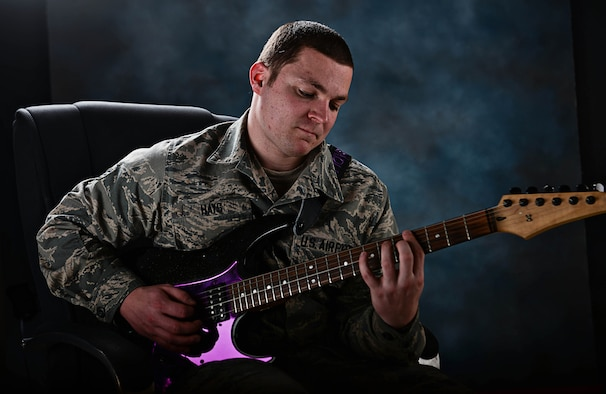 Senior Airman Trenton Hays, 37th Aircraft Maintenance Squadron sortie support technician, plays guitar at Ellsworth Air Force Base, S.D., March 9, 2015. Hays' talent as a guitarist led to him being selected to join the Air Force's premier entertainment unit, Tops in Blue, for its 2015 tour season. (U.S. Air Force photo by Airman 1st Class Zachary Hada/Released)