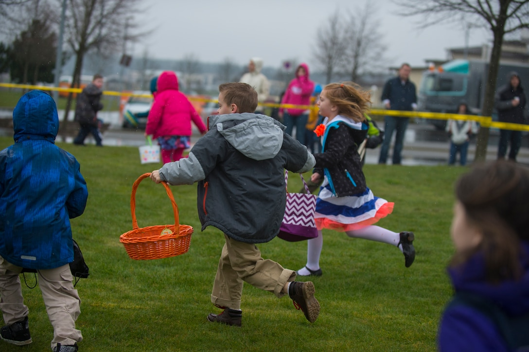 Children search for plastic eggs during an Easter egg hunt on the grass field outside Club Eifel at Spangdahlem Air Base, Germany, April 4, 2015. There were multiple egg hunts for the different age groups participating. (U.S. Air Force photo by Airman 1st Class Luke Kitterman/Released)