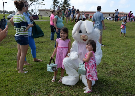 Children pose with the Easter bunny during an Easter egg hunt April 4, 2015, at Arc Light Memorial Park on Andersen Air Force Base, Guam. The event, which used approximately 7,000 eggs, was sponsored by a host of base agencies and drew more than 650 children. (U.S. Air Force photo by Senior Airman Cierra Presentado/Released)