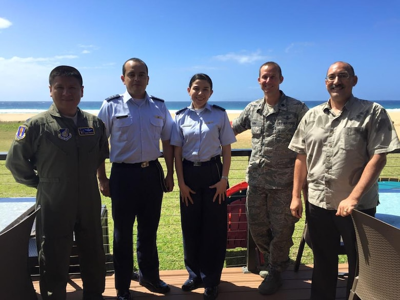 (From left) U.S. Air Force Lt. Col. Erick Fonseca, Colombian air force Capitans Fabio Sandoval and Andrea Correchea, Lt. Col. Trae York and XXXXXXXXX from the whatever, pose for a photo near the beach in Hawaii during the Colombian space familiarization trip in February. (Courtesy photo)