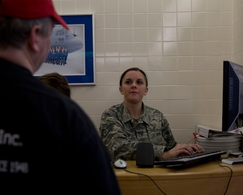 U.S. Air Force Staff Sgt. Heidi Boehnen, 133rd Force Support Squadron, Sustainment Services Flight, checks-in people in St. Paul, Minn., March 22, 2015. Boehnen's Sustainment Services Flight is one of three Air National Guard units that are being evaluated for the Senior Master Sgt. Kenneth W. Disney Food Service Excellence.