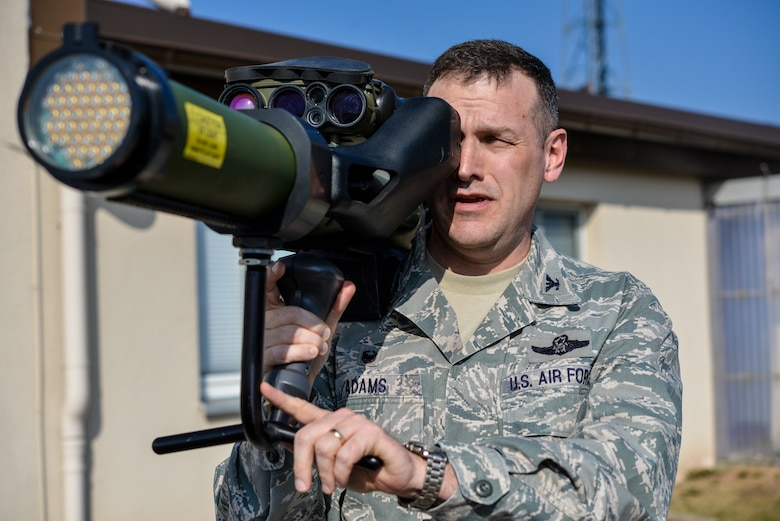 U.S. Air Force Col. Cloyce Adams, Polygone Warrior Preparation Center Detachment 3 commander, holds a man-portable aircraft at the Polygone Control Center in Bahn, Germany, March 18, 2015. The PWPC opened the new PCC, which is a multimedia training hub for NATO aircrew exercises. (U.S. Air Force photo/Senior Airman Nicole Sikorski)