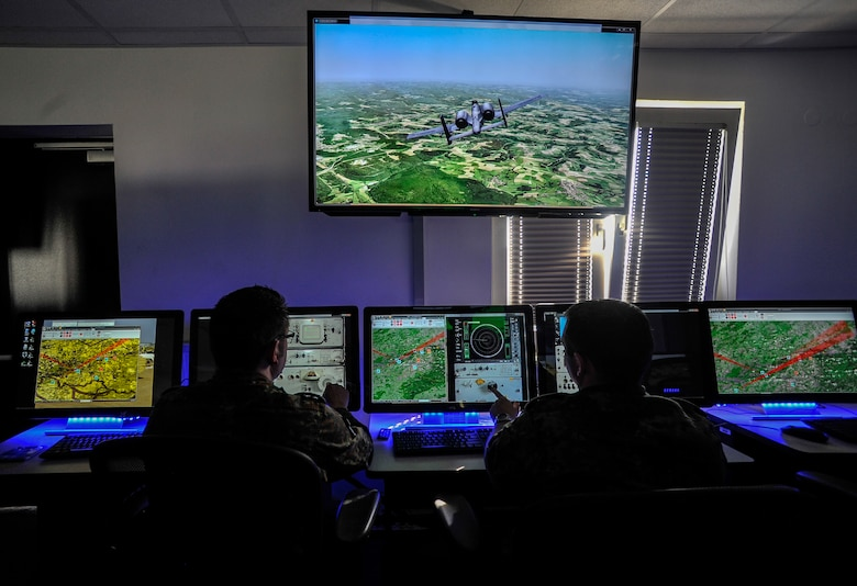 German soldiers direct a surface-to-air attack during a Multinational Aviation Live Virtual Constructive Training System exercise at the Polygone Control Center in Bahn, Germany, March 18, 2015.  The Polygone Electronic Warfare Range enhanced its training capabilities to provide service members a life-like experience with the use of the PCC. (U.S. Air Force photo/Senior Airman Nicole Sikorski)