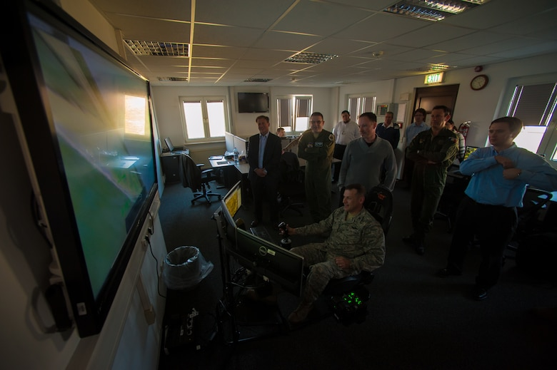U.S. Air Force Col. Cloyce Adams, Polygone Warrior Preparation Center Detachment 3 commander, uses the Multinational Aviation Live Virtual Constructive Training System at the Polygone Control Center in Bahn, Germany, March 18, 2015.  The Polygone range acts as a virtual training center for pilots where they communicate with PCC operators during NATO surface-to-air exercises. (U.S. Air Force photo/Senior Airman Nicole Sikorski)