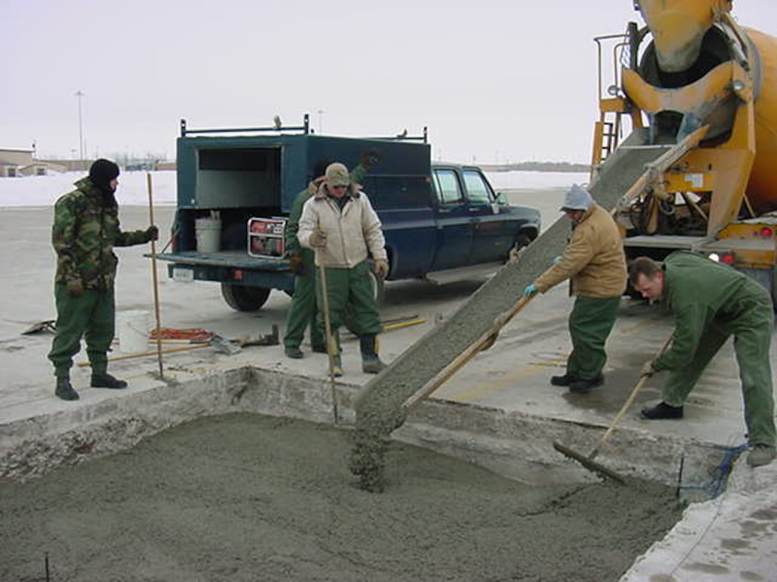 The US Air Force 319th Civil Engineering Squadron places antifreeze concrete during an airfield repair at Grand Forks Air Force Base, North Dakota, during February. Normal concrete would have required costly thermal protection.
